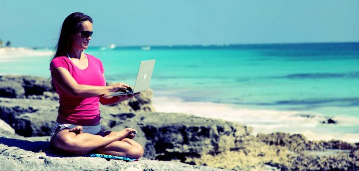 Be a better manager looking at websites on a beach