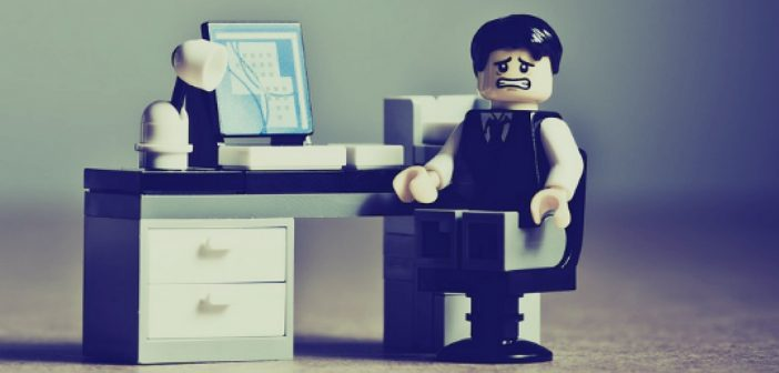 I hate my job lego man at desk